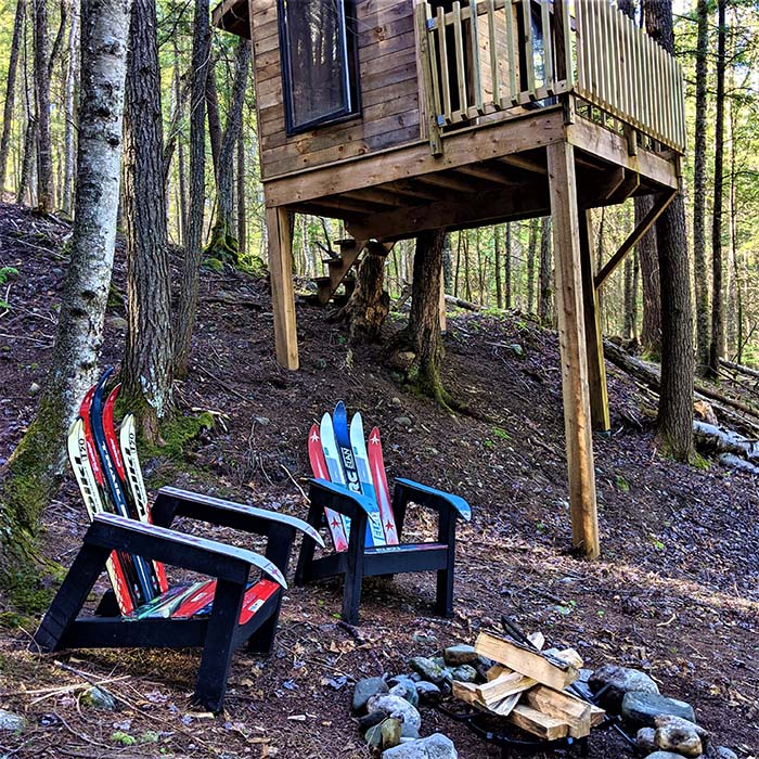 A new fire pit grate inspires the building of a focal point for relaxing outside the family treehouse.